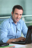 Man working at laptop computer Royalty Free Stock Photo