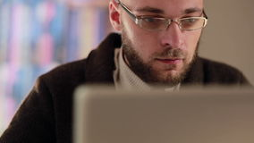 Man working on laptop computer in the workplace stock footage