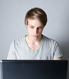 Young man working on laptop Stock Photography