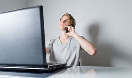 Young man working on laptop royalty free stock images