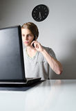 Young man working on laptop Stock Images