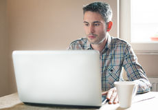 Man working on a laptop Royalty Free Stock Photo