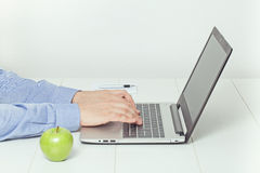 Man working on laptop. healthy eating at office. Healthy eating concept at office stock images