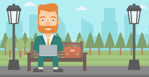 Man working on laptop. A hipster man with the beard sitting in the park on a bench and working on a laptop vector flat design illustration. Horizontal layout Royalty Free Stock Photography
