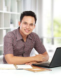 Man working with laptop at his desk Royalty Free Stock Image