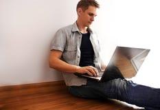 Man working on the laptop Stock Photos