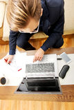 Man working on laptop at home Royalty Free Stock Photo