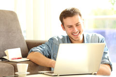 Man working with a laptop at home Stock Photos