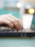 Man is working on laptop at home. Shallow depth of field Royalty Free Stock Photography