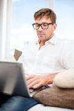 Man working with laptop at home Royalty Free Stock Photos