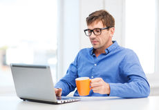 Man working with laptop at home Stock Images