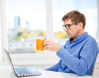 Man working with laptop at home Stock Photography