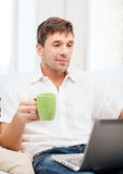 Man working with laptop at home Royalty Free Stock Images