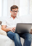 Man working with laptop at home Stock Photos
