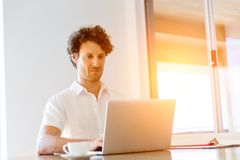 Man working on laptop at home Stock Photography