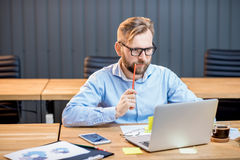Man working with laptop indoors Royalty Free Stock Photography
