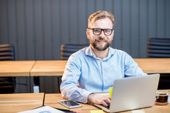 Man working with laptop indoors Royalty Free Stock Photos