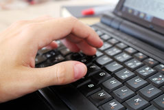Man is working with laptop in the office. Photo of man working with laptop in the office stock illustration