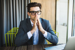 Man working with laptop outdoor. Thinking man with praying hands. Royalty Free Stock Photos