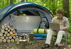 Man Working Outdoors In A Tent Camp. Stock Photography