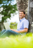 Man working on Laptop Outside Stock Images