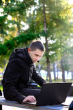 Man Working on Laptop at the Park Stock Photo