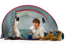 Man working with laptop in a tent Royalty Free Stock Photo