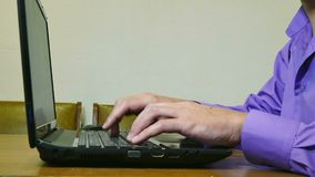 Man working on a laptop typing text. Man  working on a laptop typing text stock video