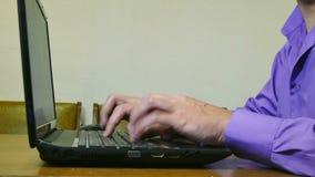 Man working on laptop typing text. Man  working on laptop typing text stock footage