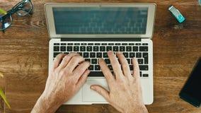 Man working with Laptop on Vintage Wooden desktop. stock video