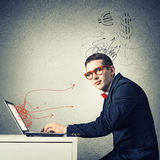Man working on laptop Stock Photography