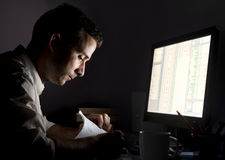 Man working late Stock Photo