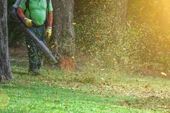 Man working with leaf blower. Man working with leaf blower in the park royalty free stock images