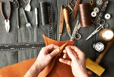 Man working with leather Stock Photography