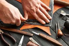 Man working with leather Stock Photos