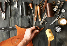 Man working with leather Stock Image
