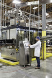 Man working on machinery in bottling industry Royalty Free Stock Photos
