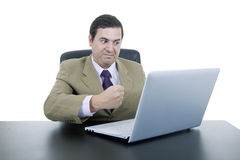 Man working. Mad business man working with is laptop Royalty Free Stock Photo