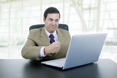 Man working. Mad businessman working with is laptop, at the office Stock Image