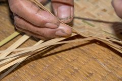 The man working for make bamboo woven close up view. The man working for make bamboo woven with hand close up Royalty Free Stock Images
