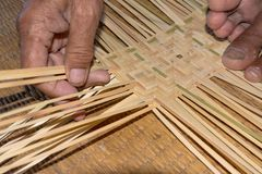 The man working for make bamboo woven close up view. The man working for make bamboo woven with hand close up Stock Images
