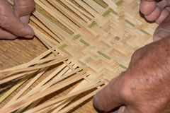 The man working for make bamboo woven close up view. The man working for make bamboo woven with hand close up Stock Photos