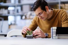Man working with maquette in design and engineering architecture. Man working in design and engineering architecture office Stock Photo