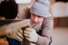 Man working with metal construction handmade in the workshop stock photo