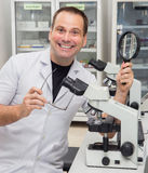Man working with a microscope Stock Photos
