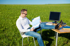 Man working in a mobile office Stock Photo