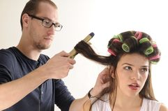 Man working with model hair Stock Photos