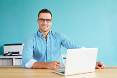 Man working in modern office on computer Royalty Free Stock Images