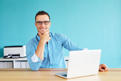 Man working in modern office stock photography