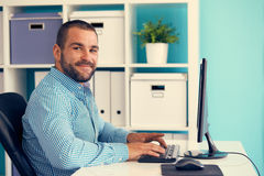 Man working in modern office, toned Stock Photos